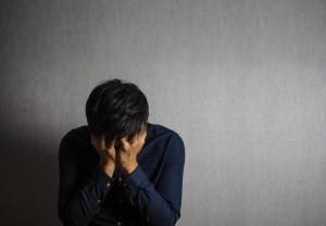 Man making facepalm gesture, sad and depression gesture