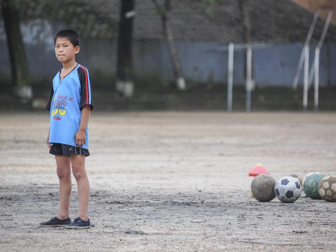 Schoolchild playing Football, North Korea